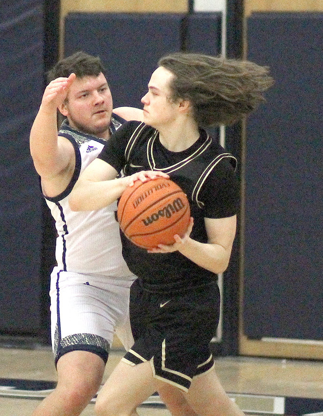 BRADLEY CENTRAL senior Tucker Greene (with ball) pumped in a career-high 21 points to lead the Bears to a 67-40 District 5-AAA victory Friday evening, in Soddy-Daisy.