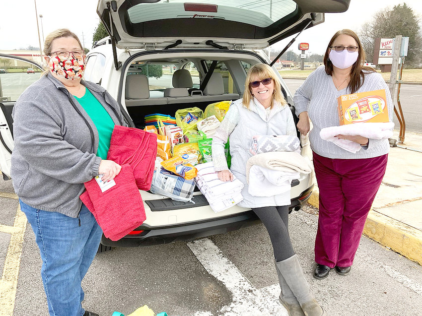With a spike in COVID-19 cases the Alpha Theta Chapter of Alpha Delta Kappa, an international honorary sorority for educators, staged an Alpha Theta parking lot collection for January's altruistic items. Assisting with January's donation of towels, blankets, and laundry detergent for Bradley County Emergency Shelter are, from left, Carol Peace, Tennessee Altruistic chair; Jill McGuire, OMS; Kelly DeLaLuz, president. Alpha Theta also collected individually wrapped snacks, cookies, protein bars, and chips, for The  Bradley Student Union @ Cleveland State Community College.  These two generous donations will be delivered next week by our Altruistic committee team. The altruistic committee members are Vivian McCormack, Angela Gardener, Adelia Hall, and Jill McGuire, chair.