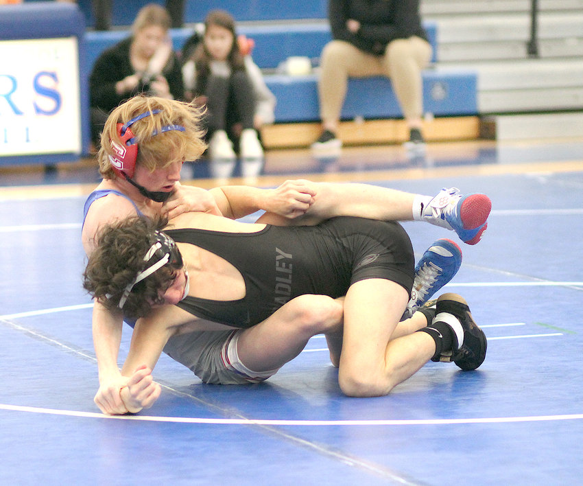 CLEVELAND WRESTLER Bentley Ellison (back) works against Bradley Central's Ethan Lipsey in the 113-pound bout at the Region 4 tournament Saturday, at Cleveland.