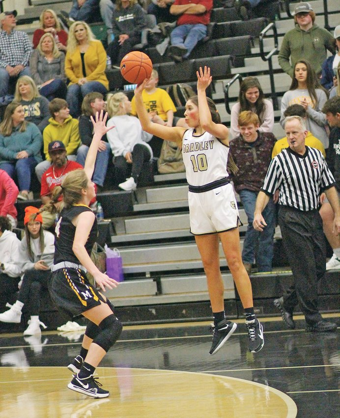 "BRADLEY CENTRAL junior Karsee Weber (10) fires up one of her half-dozen 3-pointers in Monday evening's District 5-AAA Championship Game, at ""The Jim."" Earning All-Tournament honors, Weber scored a career-high 20 points in leading the top-ranked Bearettes to their 11th straight district crown."