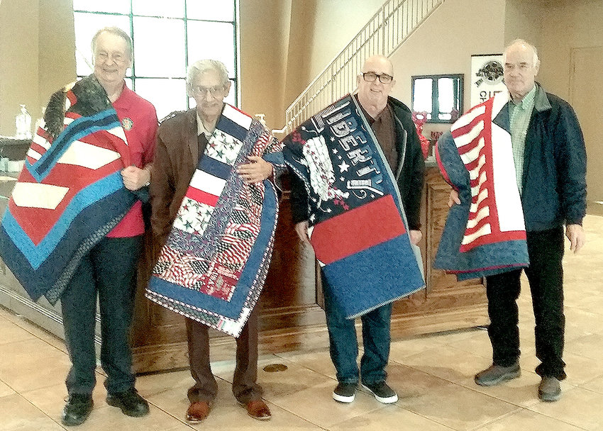 THESE FOUR VETERANS were honored Saturday with special gifts from the Cherokee Blossom Quilt Guild. Receiving the Quilts of Valor were, from left, Tim Green, Noé Estrada, Steven Brummett, and Donald Willis.