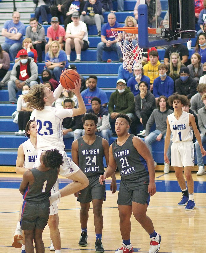 CLEVELAND SENIOR Kley McGowan (23) heads to the hoop for two of his 23 points in the first half of the Region 5-AAA championship game against Warren County Thursday, inside Raider Arena.