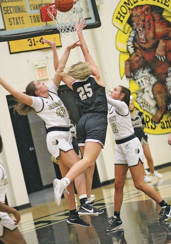 """BRADLEY CENTRAL'S Anna Muhonen (43) shut down Tennessee Miss Basketball finalist Tessa Miller to lead the top-ranked Bearettes to a 60-36 blowout of sixth-ranked Stone Memorial for the third straight year to claim the Region 3 Championship Wednesday evening, in """"The Jim."""" Bradley sophomore Hannah Jones (42) netted 14 points in the victory."""