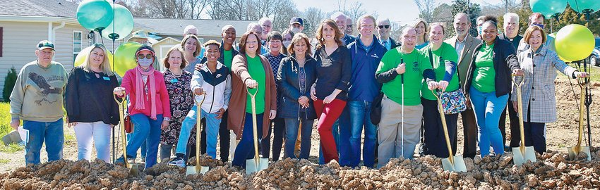 FUTURE HOMEOWNERS, Habitat representatives, volunteers, builders and dignitaries join together for a group photo following Thursday's celebration.