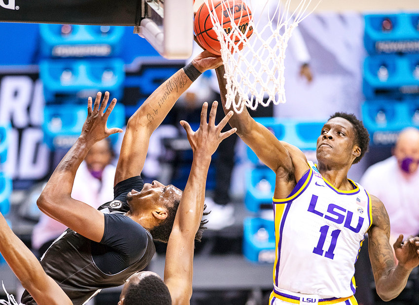 ST. BONAVENTURE FORWARD Osun Osunniyi (21) tries to get a shot past LSU forward Josh LeBlanc Sr. (11) in the first half the first round  the NCAA tournament, Saturday, at Assembly Hall in Bloomington, Ind.