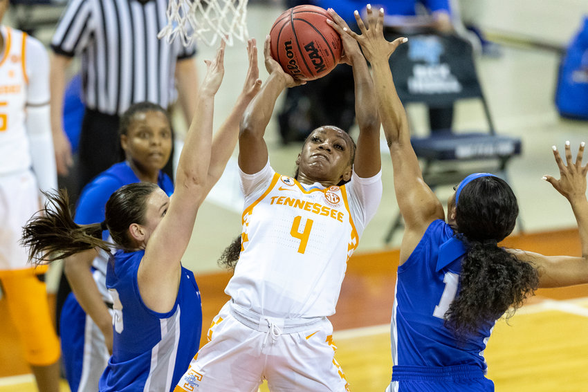 TENNESSEE JUNIOR Jordan Walker (4) tries to get off a shot against a tough Middle Tennessee defense during Sunday's NCAA Tournament opener.