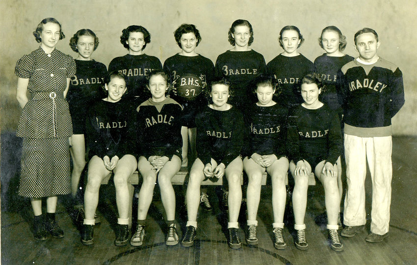 COACH CECIL GRAY'S (standing on right end) first Bradley Central Bearette team in 1936-37 went 18-2 and finished second in the region tournament. After suffering just one loss during the regular season, the Bearettes swept the district tournament with wins over South Pittsburg, Sweetwater and McMinn County. In the region, Bradley defeated Robertsville, Mosheim and Jacksboro before dropping the championship game 47-44 to Greeneville. Team members included  captain Myrtle Dooley, Ulene DeWeese (front row, right end), Dorothy (Kellar) White (second from left on back row), Rosealthe (Lacy) Crye (seventh on back row), who went on to play at the University of Chattanooga on athletic and academic scholarships, Lucy Moore, Iona Henson, Mildred Irvin and Elsie Legard. Yolanda (Ledford) Ramsey (standing first on left) was the team manager.