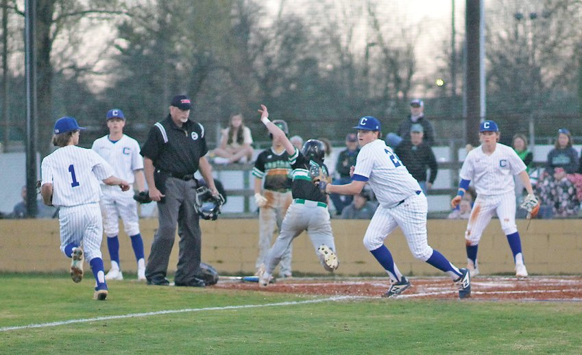 CLEVELAND HIGH senior Hayden Sells (24) tags out an East Hamilton base runner to finish a run down with teammate Hayden Tinsley (1) during Monday evening's District 5-AAA action, at Raider Field.
