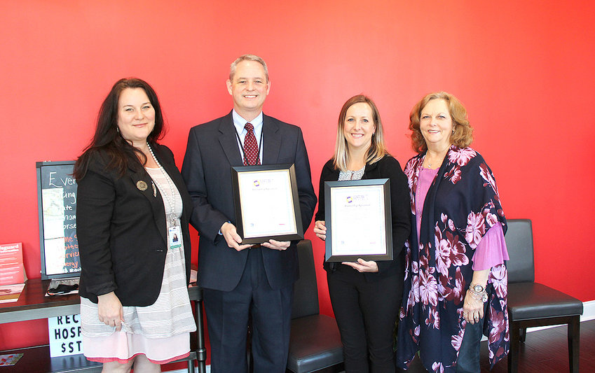 From left are Kelly Brownlow and Randall Stephens from Mayfield Elementary School, Misty Allen, State Farm, and Sherry Crye, Cleveland/Bradley Chamber of Commerce