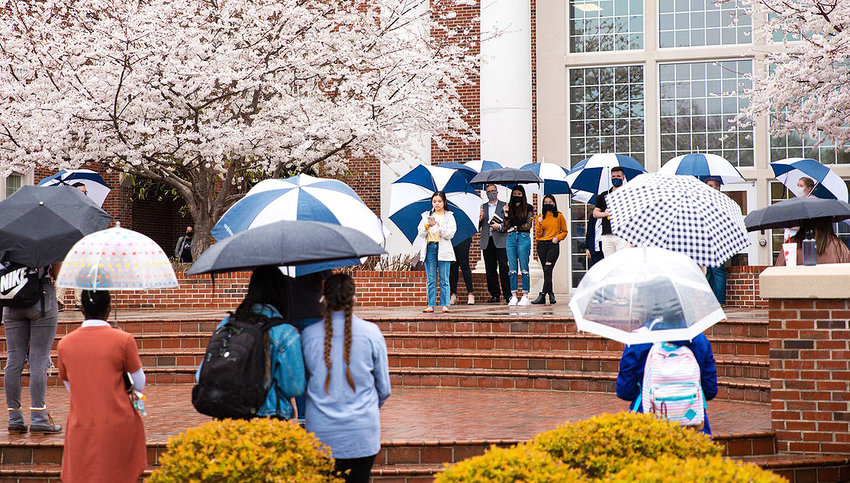 Lee University students, staff, and faculty gather to pray, worship, and honor the victims of the recent Atlanta shooting and other victims of hatred. Lee student Jasmine Ngo, center, shares victims' stories.