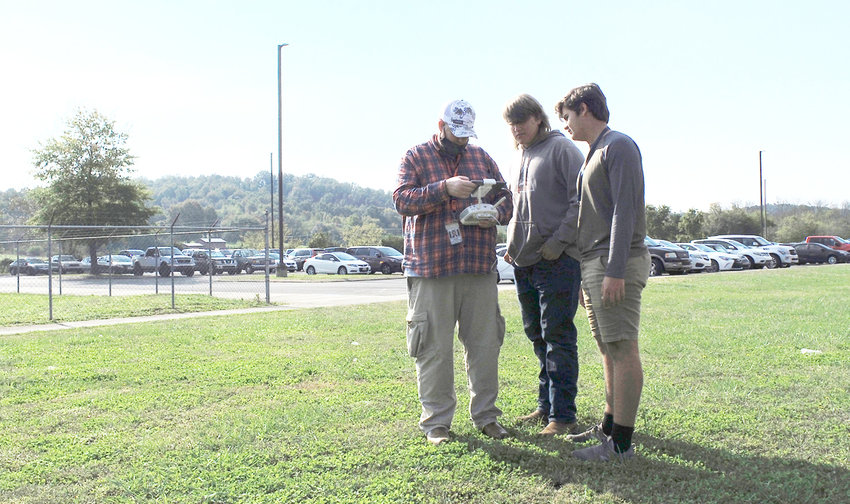 WALKER VALLEY HIGH SCHOOL students in the unmanned aviation class prepare a drone to fly on campus, giving them a sky-high view of the area.