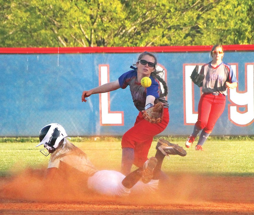 BRADLEY CENTRAL senior Riley Sermons slides safely into second base on a fielder's choice as Cleveland shortstop Miriam Eachus tries to get a handle on the throw during Thursday's District 5-AAA action, at Brenda Lawson Field.