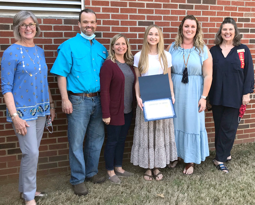 Delta Kappa Gamma met on April 7, 2021 to award the Katherine Trewitt Scholarship to Bradley Central High School student, Hannah Maupin. The scholarship is awarded annually to a local senior who is planning to attend college to study education. Pictured from left to right:  Scholarship Committee Chairperson, Patty Puckett; Hannah's parents, Coy and Jamie Maupin; scholarship recipient, Hannah Maupin; DKG Lambda President, Lara McTaggart; and DKG Tennessee State President, Dr. Beverly Hall-Maughan