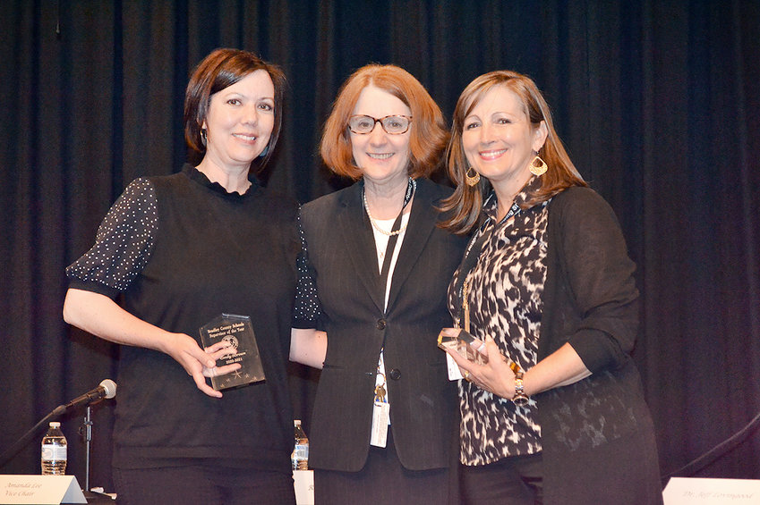 SUPERVISORS OF THE YEAR for the Bradley County Schools are Emily Brown, left, and Angie Gill Tuck, right, who were both recognized at the Board of Education meeting Thursday evening. Dr. Linda Cash, director of schools, presented the awards.