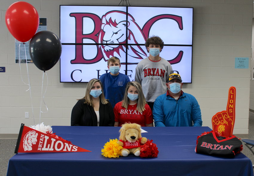 "WALKER VALLEY High School cheerleader Kaylee Ownby signs with Bryan College on Tuesday with her family at her side. Behind her are brothers Brody and Tucker Ownby; to her left is her mother, Cristy Ownby, and to her right is Chad ""The Rad Dad"" Ownby."