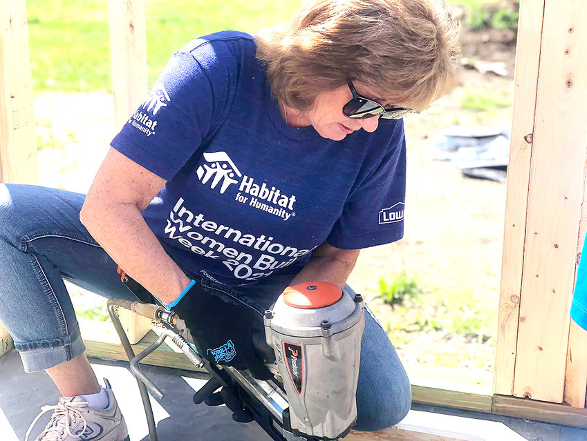PATTY SILVERMAN volunteers during the Women Build 2021 for Habitat for Humanity of Cleveland. Four homes are to be built by volunteers and others this year.