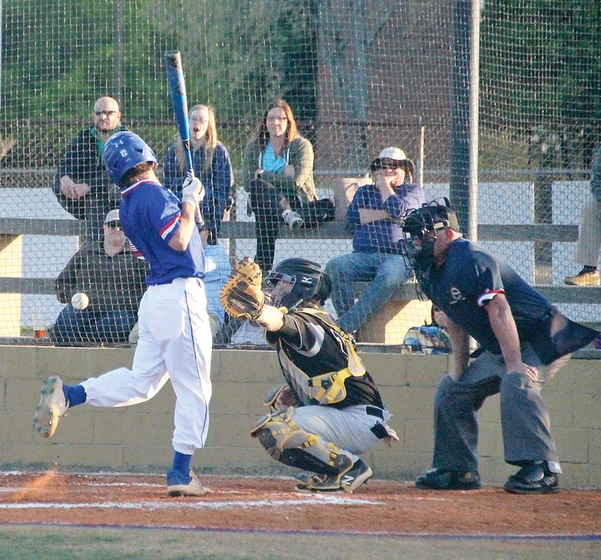"""CLEVELAND HIGH senior Hayden Tinsley gets """"plunked"""" during Thursday evening's action against Hixson, at Bill Tally Stadium."""