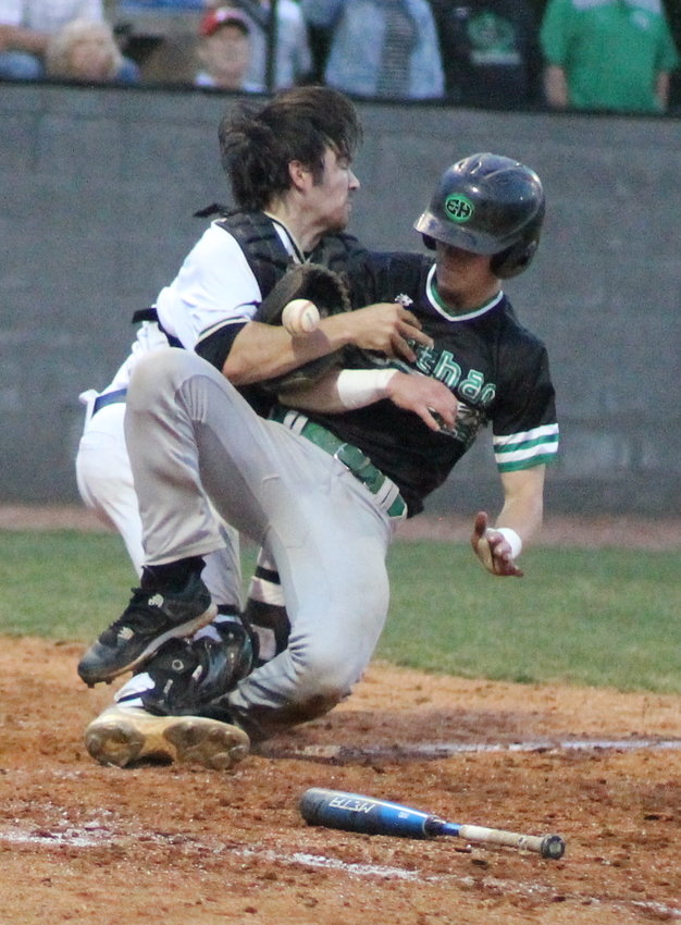 EAST HAMILTON senior Chase Roberts, right, uses his knee to dislodge the ball from Bryan College signee Ethan Lamberth's mitt, but was ruled out and ejected after the violent collision at the plate during Bradley Central's 4-1 District 5-AAA victory Monday, at the McKenzie Baseball Complex.