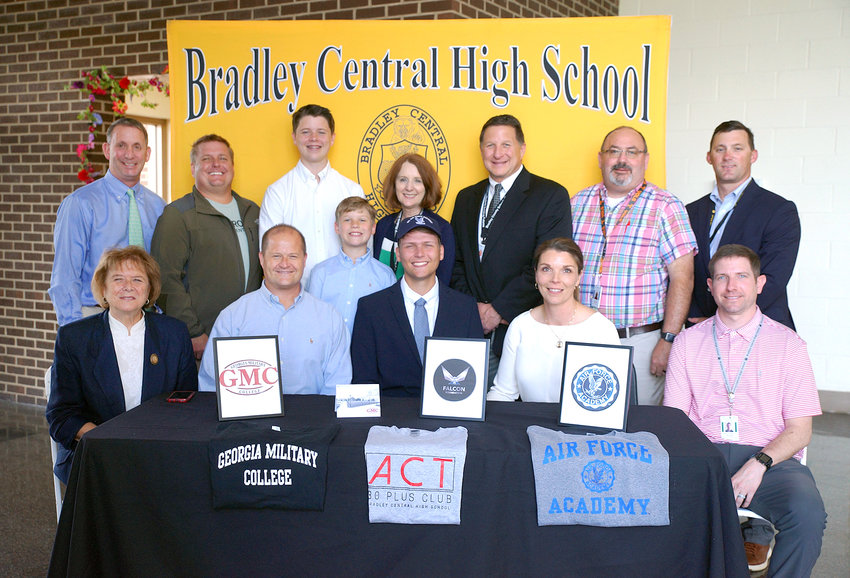 ACADEMIC ALL-STAR Luncheon/College Signing day was held Tuesday at Bradley Central High School. The luncheon honored the top ten 2021 graduates and the students who scored a 30+ on the ACT. Cole Haney was the recipient of the US Air Force Academy Falcon Scholarship. He will attend Georgia Military Academy and US Air Force Academy class of 2026. From left standing are Steve Montgomery (Prospect principal), Mickey Clark (Crossroad Community Church pastor), Grant Haney (brother), Dawson Haney (brother), Dr. Linda Cash (director of Bradley County Schools), Todd Shoemaker (secondary supervisor of Bradley County Schools), Greg Kersey (criminal justice teacher), an d Patrick Spangler (Bradley Central High School principal); and seated, Lucretia Haney (grandmother), Chris Haney (father), Cole Haney (recipient), Scherre Haney (mother), and Drew German (assistant men's basketball coach).