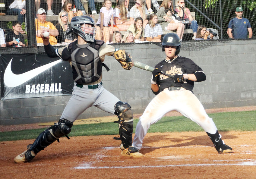 BRADLEY CENTRAL sophomore Dakota Peace (29) gets out of the way of a pitch while Silverdale catcher Ian Reagan fires to second base to nail a would-be Bear base stealer in Friday evening's 6-4 Seahawk win, at the McKenzie Baseball Complex.