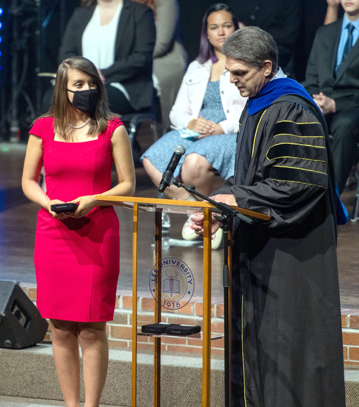 Lee President Dr. Mark Walker, right, presents Emma Posey with the 2021 F.J. Lee Award during a recent chapel service.