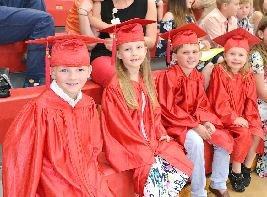 FUTURE LEADERS, CLASS OF 2033, members Greyson Pike, Emma Ferguson, Emma Scofield and Stryker Vaughn, sit awaiting their chance to be a part of the Park View Elementary School 10th anniversary ceremony.