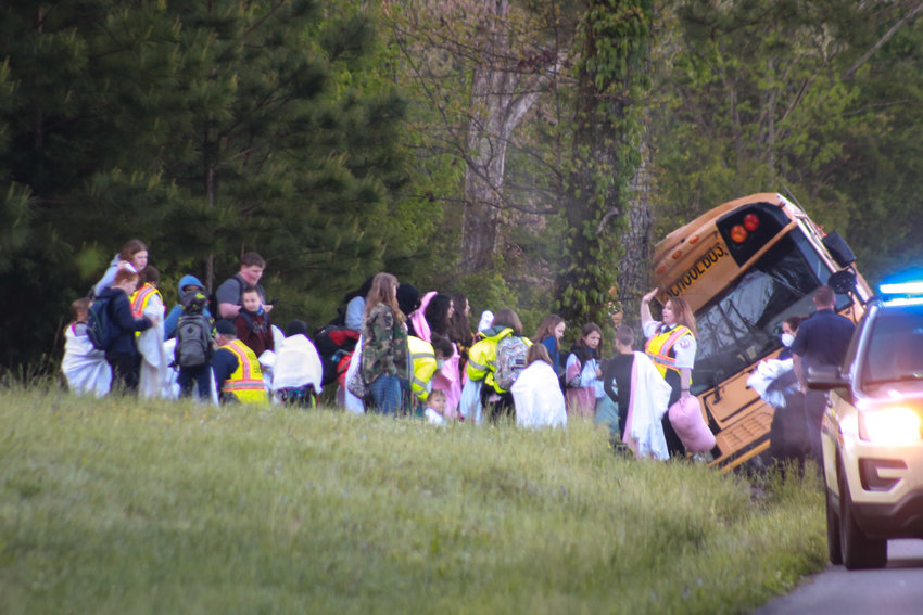 FIRST RESPONDERS check on students who were on a Bradley County bus when it crashed this morning on Brymer Creek Road. No major injuries were reported.