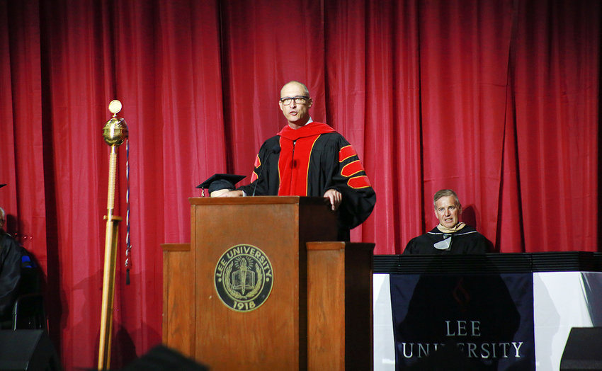 BRADLEY MOFFETT, vice president for university relations, speaks at the first of six in-person graduation ceremonies at Lee University.