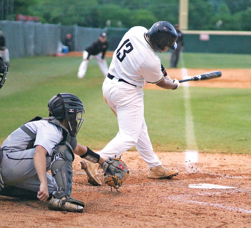 BRADLEY CENTRAL senior Iverson Vasquez (13) laced  a walk-off single to drive in the game-winning run Monday as the Bears held off McMinn County 6-5 in 11 innings to claim the District 5-AAA crown, at Ooltewah's A.C. Bud Ball Field.