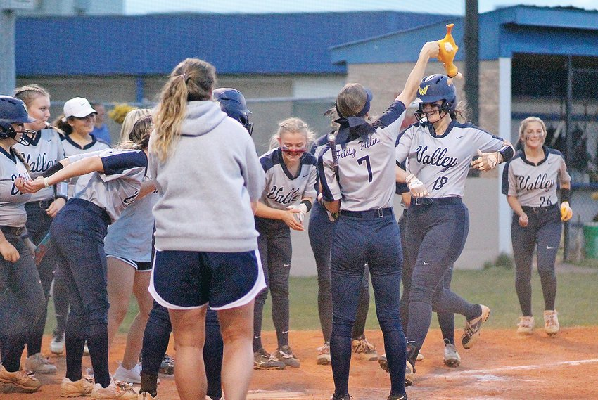 WALKER VALLEY junior Sierra Brown (18), is greeted by her teammates at home plate after having a shot leave the park for the second time During the 9-0 Feisty Fillies' win over McMinn County in District 5-AAA Tournament action Tuesday evening, at Brenda Lawson Field.