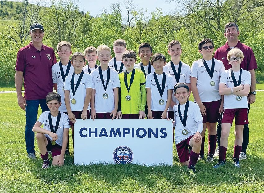 THE CLEVELAND FC BOYS soccer team won the Overmountain Cup last weekend, in Kingsport. Front row, from left, Blaise Philips and Rader Brose. Back row, from left, coach Jeff Philips, Christopher Malick, Henry Seo, Paxton Berry, Jax Rollo, Mason Pledge, Noah Houle, Edward Nunez, Thomas Seo, Aleksio Praniuk, Blake Artigas, Tristan Sanders, coach John Brose. Not pictured is Dev Patel.