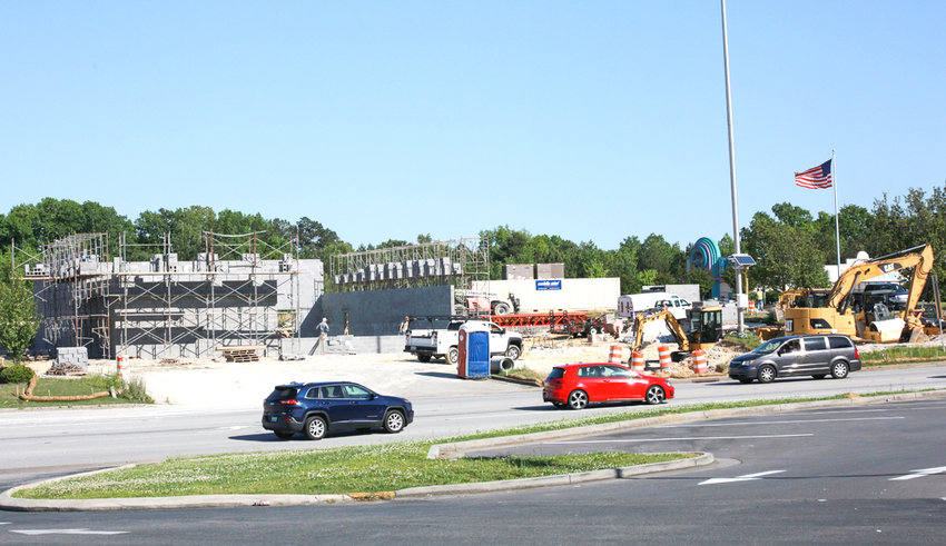 NEW CONSTRUCTION of an Auto Zone on McGrady Drive S.E. continues. A permit was issued for the project in April, with the job cost for the project exceeding $800,000.