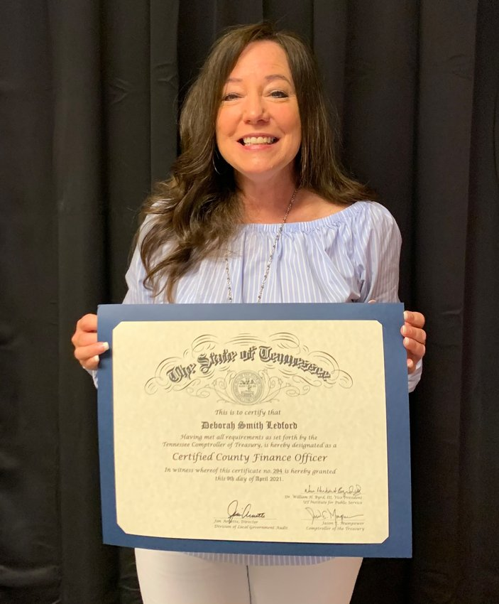 DEBORAH LEDFORD of the Bradley County Trustee's Office has earned the status of Certified County Finance Officer. Her training came through a program offered by the University of Tennessee's County Technical Assistance Service and the State of Tennessee's Comptroller of the Treasury.