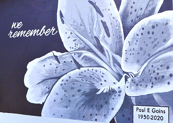 IN HONOR of the late Paul E. Goins who — with his brother, Robert — spent 22 years as a volunteer maintaining and mowing the Veterans Cemetery at Fort Hill, this mural of a stargazer lily now graces one side of a nearby storage facility which houses maintenance equipment used by the Goins brothers. Originating the idea was Amanda Peels, executive director of Keep Cleveland and Bradley County Beautiful. It was painted by CSCC art instructor Bethany Coffin and students.