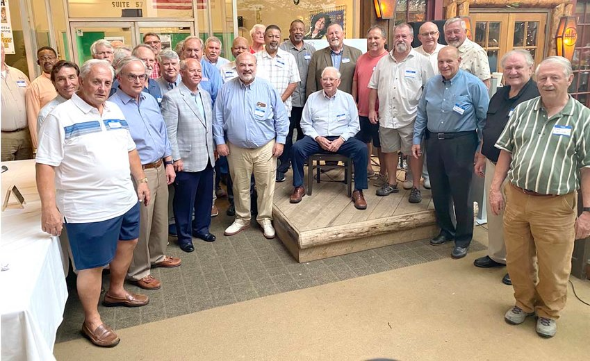 A LARGE CROWD of former players, family members, and friends turned out at True at BHB restaurant on Friday night to honor legendary Cleveland High School football coach Bobby Scott (seated).