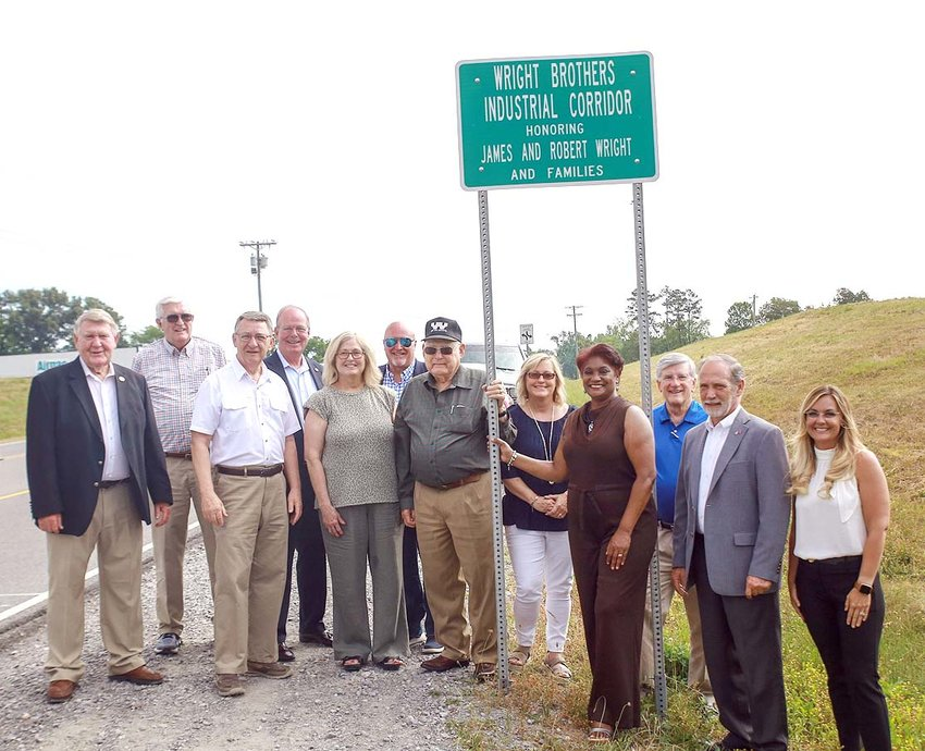 WRIGHT BROTHERS CONSTRUCTION was honored with a ceremony designating a portion of road as the Wright Brothers Industrial Corridor on Thursday. From left are Commissioner Louie Alford, Commissioner Thomas Crye, state Rep. Dan Howell, Sheriff Steve Lawson, Cindy Freeman, County Commission Chairman Johnny Mull, Robert Wright, Penny Ragland, Charleston Mayor Donna McDermott, state Sen. Todd Gardenhire, Bradley County Mayor D. Gary Davis and Commissioner Erica Davis.