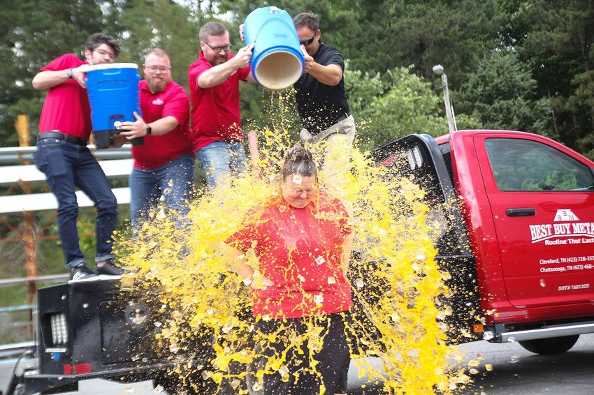 EMPLOYEES at Best Buy Metals in Cleveland douse National Sales Director Danielle Jordan with Gatorade after meeting a challenge to achieve $400,000 in sales in just eight days in order to meet their sales goal. Gale Frizzell, administrative assistant, said the employees were so motivated, they tallied nearly $775,000 in sales, with three days to spare.  The employees later pushed the number to $1 million in the last 48 hours of the challenge.
