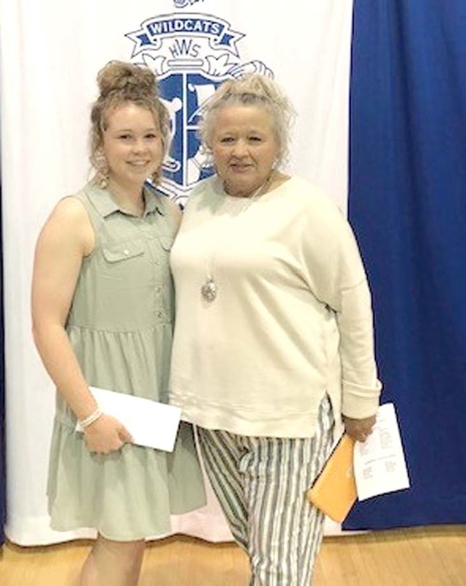 KATIE LOWE, left, a 2021 graduate of Polk County High School, has been named recipient of the inaugural Kelby Fritts Memorial Scholarship. At right is Rhonda McKnight, mother of the late Miss Fritts who died in 2018.