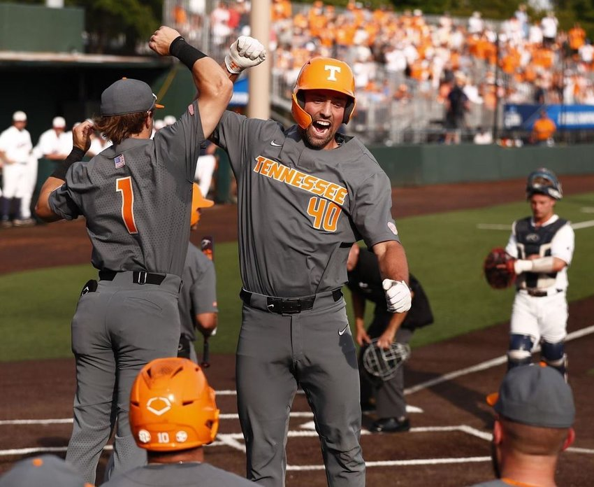 TENNESSEE VOLS Luc Lupcius (4) and Drew Gilbert (1) celebrate after one of Lucios' two home runs in Saturday's 9-3 victory over pLiberty to advance to the NCAA Region championship game. Lupcius and Liam Spence both smached a pair of dingers, while Gilbert, who had a walk-off grand slam Friday evening, added a solo shot.