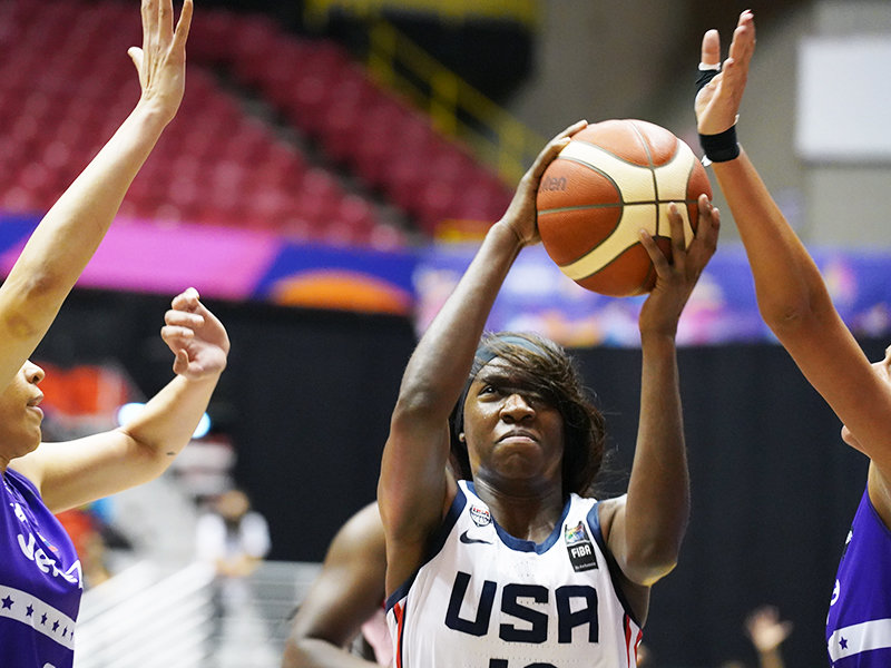 FORMER BRADLEY CENTRAL standout Rhyne Howard, center, goes up for two of her 17 points in the USA's 102-53 rout of Venezuela in the FIBA Women's AmeriCup Monday evening at the Roberto Clemente Coliseum in San Juan, Puerto Rico.