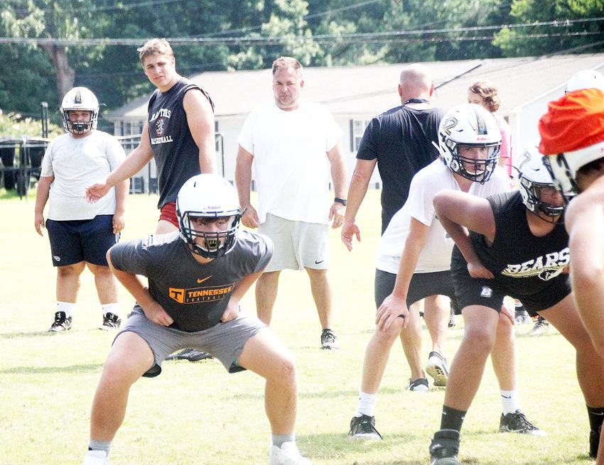 FORMER BRADLEY CENTRAL lineman Todd Burkhart, center, has returned to his alma mater and has taken over as the Bears' offensive coordinator.
