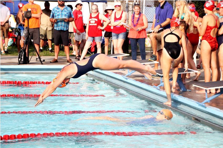 HEADING INTO the water as part of a Cleveland Aqua Tiger relay team, Bre Belcher was a Tennessee state champion and a three-time All-American at The Baylor School in Chattanooga and is now heading to swim for Carson-Newman University.