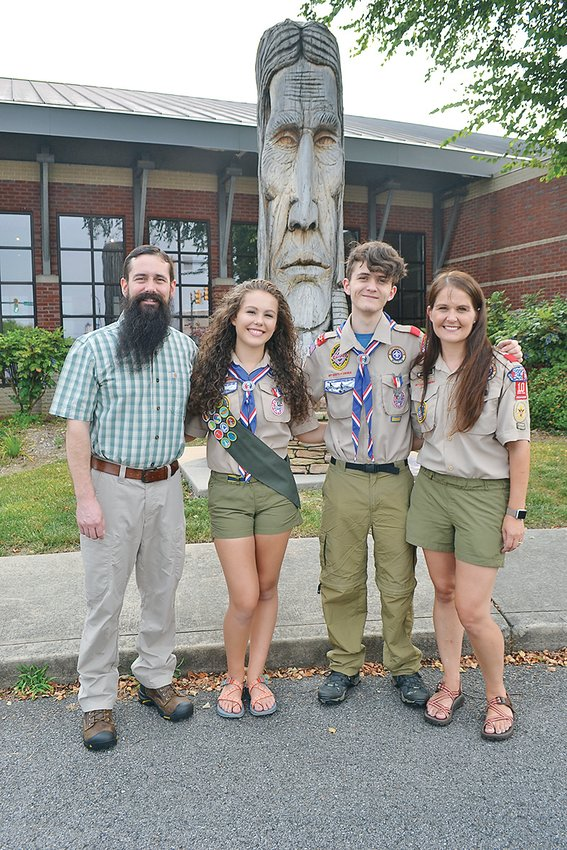 ANIKA PIERCE is officially an Eagle Scout following her Court of Honor ceremony held recently at the Museum Center at 5ive Point. Proudly standing in front of the Cherokee Chieftain in front of the museum are her father Niles Pierce; Anika; her brother, Hunter, also an Eagle Scout; and mother Bianca.