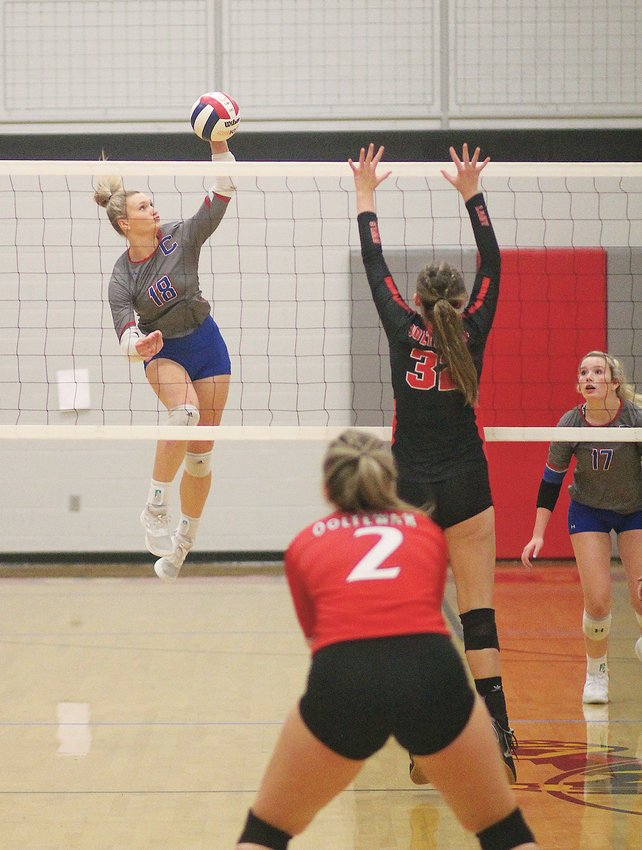 LADY RAIDERS' Kinslee McGowan sends a shot over the net against the Lady Owls during game one of a District 5-3A volleyball matchup Tuesday, at Ooltewah.
