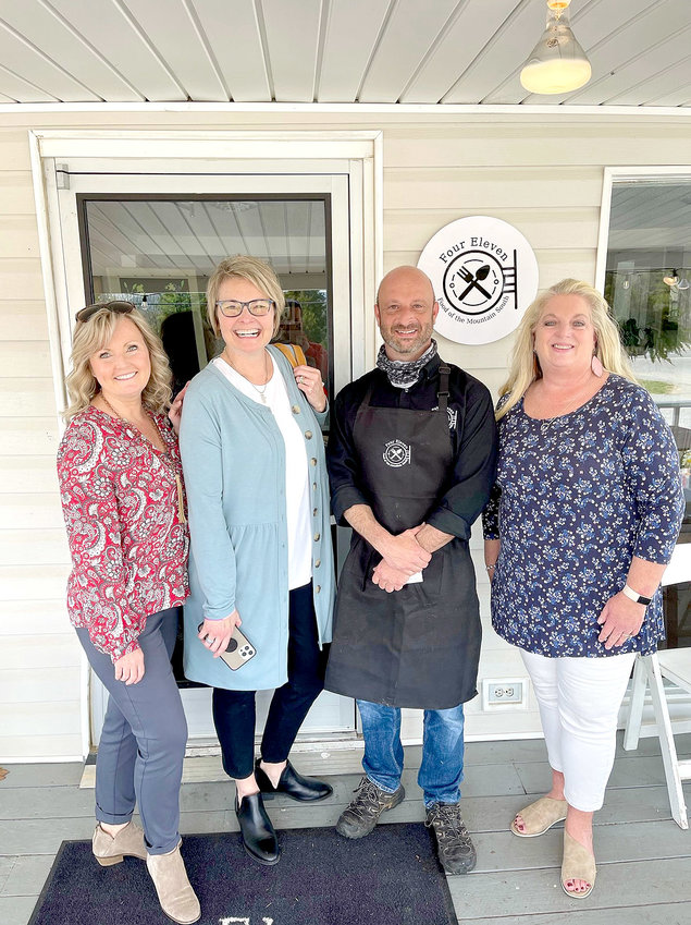 JOSEPH KEEL, second from right, one of this year's chefs at the International Cowpea Festival and Cook-off, welcomes everyone to come to The Four Eleven and enjoy the food and atmosphere. Visitors at the restaurant have included, from left, Mary Tom Jenkins and Melissa Woody of the Cleveland/Bradley Chamber of Commerce, and Lynne McClary of the Polk County Chamber of Commerce.