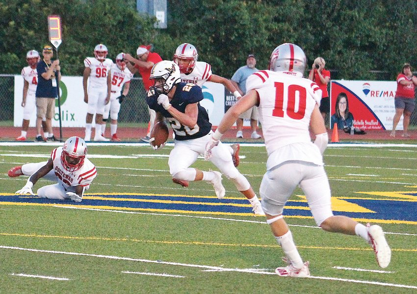 """WALKER VALLEY wide receiver Kade Tjaarda (28) breaks free for a 66-yard touchdown on a pass from quarterback Ryan Lay in the first quarter against Ooltewah in the Region 4-5A opener, inside """"The MAC"""" Friday. The Mustangs won 48-7."""