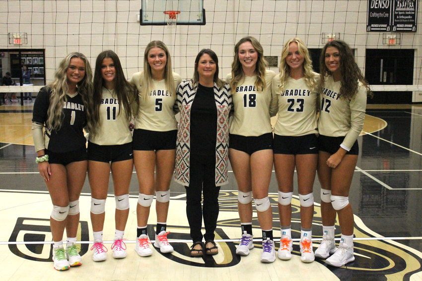 """BRADLEY CENTRAL honored their volleyball seniors Monday evening before sweeping Red Bank, at """"The Jim."""" Seniors honored were, from left, Abigail Leonard, Courtney Carroll, Karson Morrison, """"Mama Bear"""" Christie McElhaney, Ava Koger, Ashlan Crittenden and Calli Elrod."""