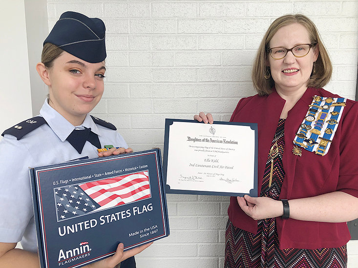 Ocoee Chapter presented an American flag flown over Memorial Continental Hall at National Society of Daughters of the Revolution Headquarters in Washington, D.C., to Civil Air Patrol Cadet First Lt. Ella Kidd. Kidd volunteers to raise and lower the American flags at the local government buildings. Ocoee Chapter is proud to recognize patriotic citizens who respect the flag of the United States of America. The flag presented was flown to commemorate Flag Day on June 14th in her name. The National Society Daughters of the American Revolution was founded in 1890 to promote historic preservation, education, and patriotism. From left are Kidd and Leigh Ann Boyd, Ocoee Chapter regent.