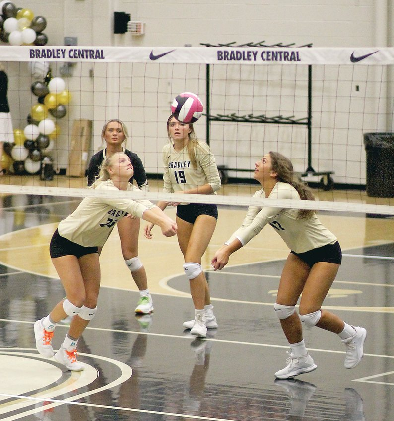 """BRADLEY CENTRAL seniors Ashlan Crittenden (23) and Calli Elrod (12) both go for the dig as teammates Trinity Reagan (19) and Abigail Leonard look on during Monday evening's sweep of Red Bank, at """"The Jim."""""""