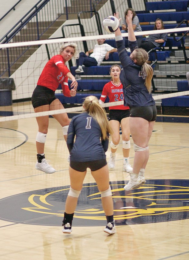 """CLEVELAND'S Jordan Whitcraft (21)  sends a shot over the net as Walker Valley's  Grace Martin (44) goes for the block in the first set of a district volleyball match Tuesday evening, at """"The Stable."""""""